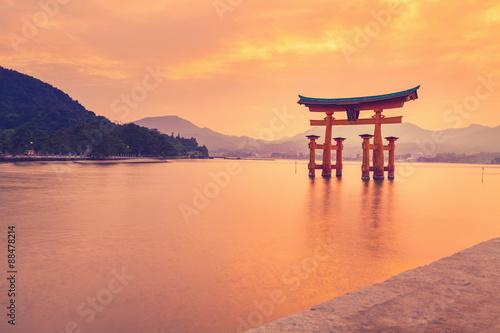 Fototapeta The famous orange shinto gate (Torii) of Miyajima island, Hiroshima prefecture, Japan.