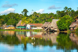 View of a small village in the Amazon rain forest on the shore of the Yanayacu River in Peru - 88513810