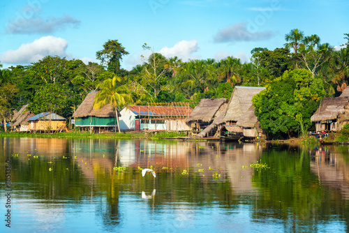 Fototapeta View of a small village in the Amazon rain forest on the shore of the Yanayacu River in Peru