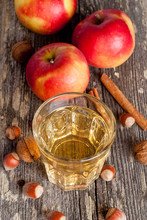 apple cider or juice in a glass, close-up