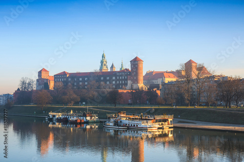 sunrise over the historic royal Wawel Castle in Cracow, Poland © dziewul