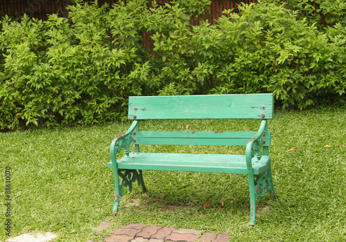 Fotobehang Tuin chair in the park as green grass color