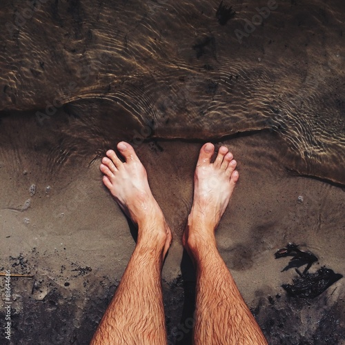 man legs on the beach