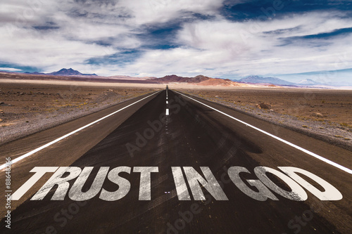 Trust in God written on desert road Poster
