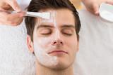 Fototapety Therapist Applying Face Mask To Man