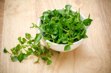 Fresh watercress in the bowl on wooden background,green vegetable - 88696850