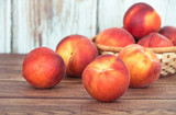 Closeup of peach fruits on wooden table