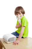 The boy with nebulizer against white background poster