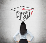 Rear view of the young brunette lady who is thinking about MBA degree. Drawn a graduation hat on the concrete background . poster