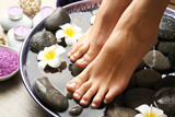 Fototapety Female feet at spa pedicure procedure