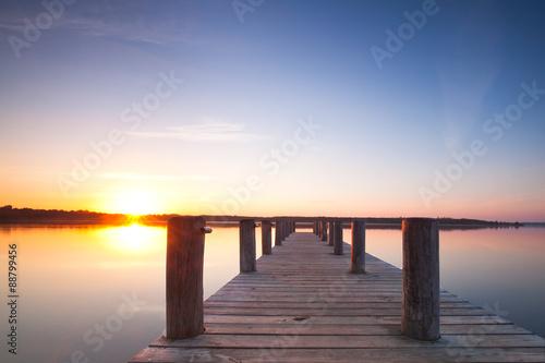 Obraz na Plexi langer Steg am Seeufer