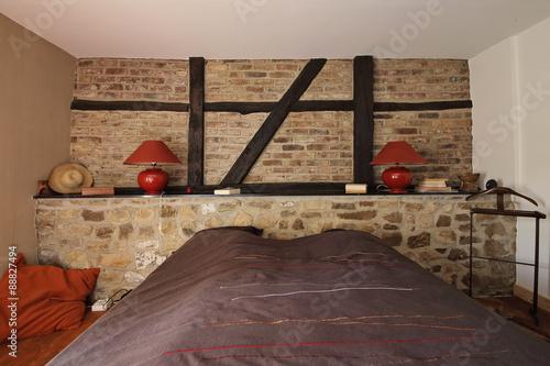 chambre en ardennes avec mur de pierre et poutres apparentes photo libre de droits sur la. Black Bedroom Furniture Sets. Home Design Ideas
