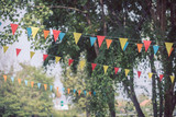 colorful triangular flags of decorated celebrate outdoor party