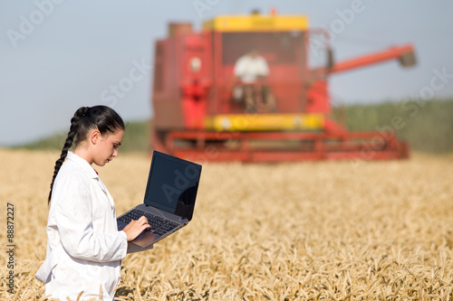 Woman agronomist in wheat field © Budimir Jevtic