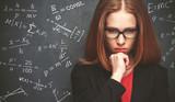 Fototapety girl student, the teacher writes on  blackboard chalk formula