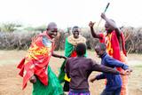 Fototapety Massai family celebrating and dancing