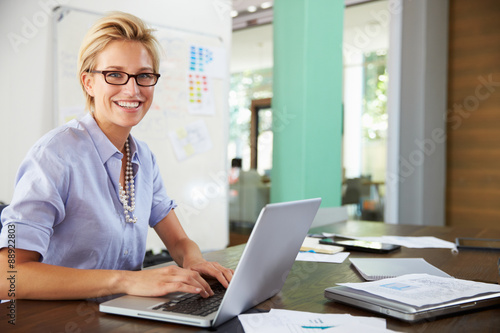 Portrait Of Businesswoman Working In Creative Office