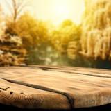 Fototapety wooden table and autumn day