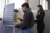 Man and woman voting