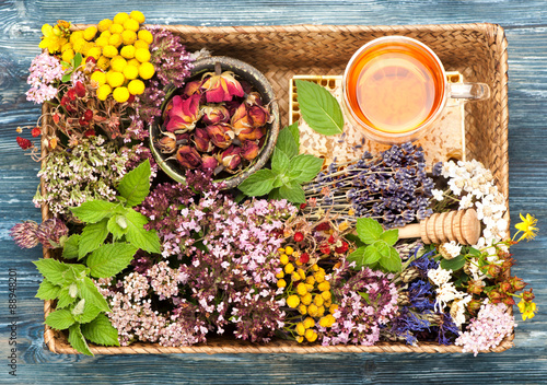 obraz lub plakat Herbal Medicine. herbs and flowers in basket. Top view, horizontal