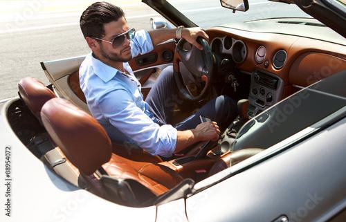 Handsome man near the car. Luxury life. - 88954072