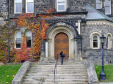 Gothic style college building with colorful fall ivy