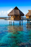 houses over the transparent quiet sea water. Tahiti - 89032865
