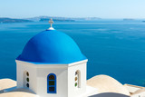 Greek church with blue dome in Oia, Santorini