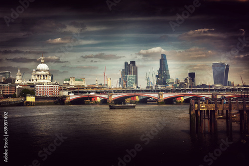 Artistic atmospheric view of London city skyline