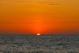 Fototapety Orange sunset in the ocean