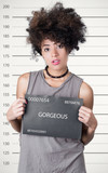 Hispanic brunette rebel model afro posing for mugshot, careless facial expression