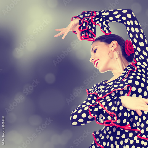 Poster Close-up portrait of a young woman dancing flamenco on abstract background