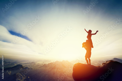 Poster Happy couple on the top of the world! Man holding woman on his arms