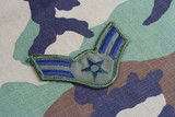 KIEV, UKRAINE - June 6, 2015. US AIR FORCE Airman First Class rank patch on woodland camouflage uniform poster