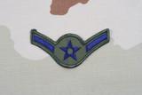 KIEV, UKRAINE - May 18, 2015. US AIR FORCE Airman rank patch on desert uniform poster