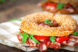 Bagel sandwich with pepperoni and tomato
