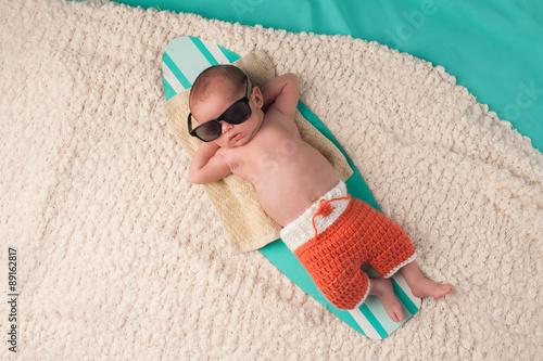fototapeta na ścianę Newborn Baby Boy Sleeping on a Surfboard