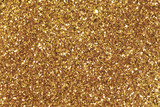Fototapety Background filled with shiny gold glitter.