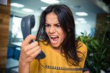 Angry businesswoman shouting on phone