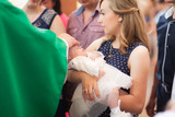 Child christening, mother hold baby