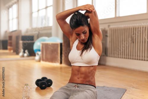 fototapeta na ścianę Fitness woman doing stretching exercise at gym