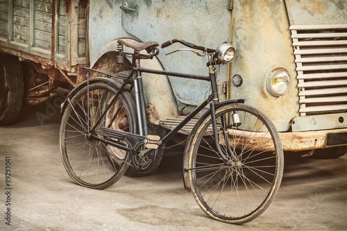 Zdjęcia na płótnie, fototapety na wymiar, obrazy na ścianę : Retro styled image of an ancient bike and truck