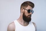 Fototapety Bearded man wearing sunglasses