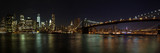 New York - Manhattan mit Brooklyn Bridge Panorama bei Nacht © lavizzara