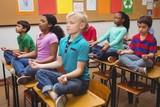 Fototapety Pupils meditating on classroom desks