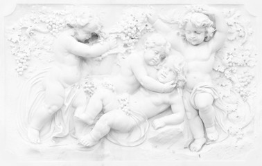 Black and white photography of basrelief with cherubs