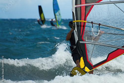 fototapeta na ścianę Three windsurfers in action