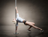 Pole dancer, blond woman dancing on pylon