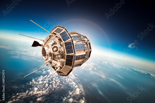 Foto op Canvas Space satellite over the planet earth