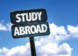 Fototapety Study Abroad sign with sky background